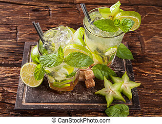 Mojito drinks on wood, upper view