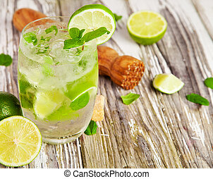 Fresh mojito drink on wooden table