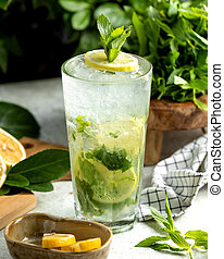 mojito glass garnished with lemon slice and mint leaves
