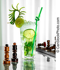 mojito glass garnished with lime and zest