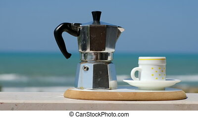 moka pot coffee maker sea background italian breakfast .