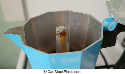 Moka pot. The mocha coffee pot on the stove for Italian...