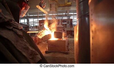 Molten metal in a steel mill in factory