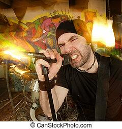 Molten metal mayhem - Metal singer cussing into the...