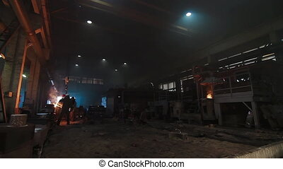 Molten metal melted in furnace at metallurgical plant. ...