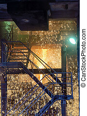 Molten Metal Pouring Out Of Furnace