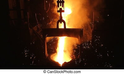 Molten steel pouring in ladle - Molten metal is being...