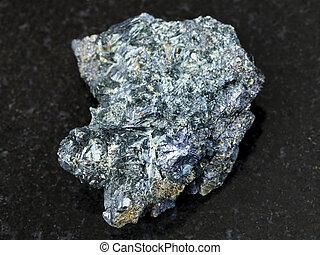 Molybdenite crystal in rough Glaucophane on dark - macro...