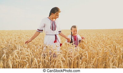 Mom and baby are going through a wheat