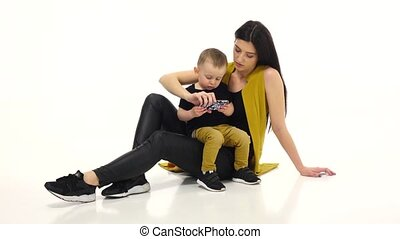 Mom and child are watching cartoons on a smartphone. White background