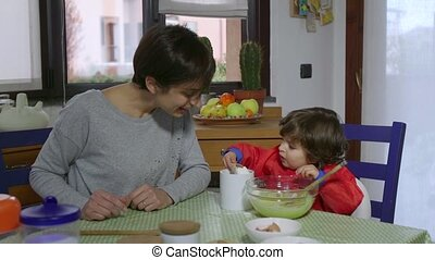 Mom And Child Cooking Food And Cake