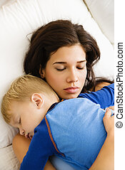 Mom and child sleeping.