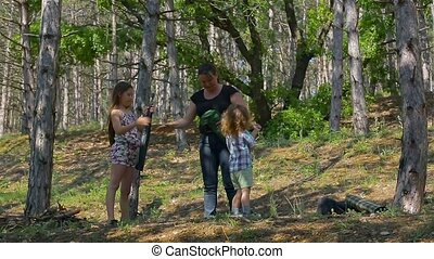 Mom and Dad collected a tent. Kids in the woods - Family...
