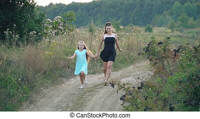 mom and daughter are running - Mom and daughter are running...