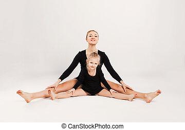 Mom and daughter do gymnastics