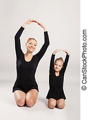Mother and child daughter make fitness exercises