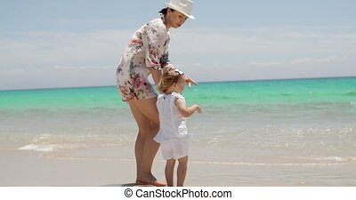 Mom and Daughter Enjoying at the Beach on Summer