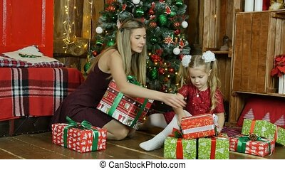 Mom and daughter give presents for the new year