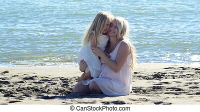 Mom and daughter hugging and playing
