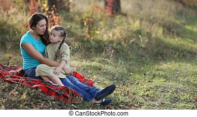 Mom and daughter in nature