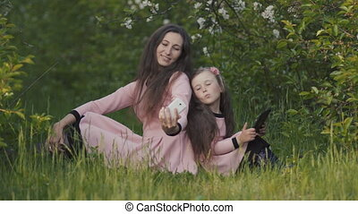 Mom and daughter in the spring garden