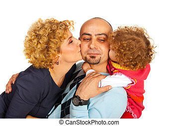 Mom and daughter kissing dad