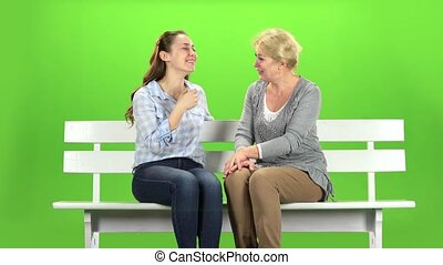 Mom and daughter laugh. Green screen