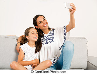 Mom and Daughter making a selfie