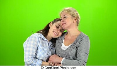 Mom and daughter on talking . Green screen - Mom and...