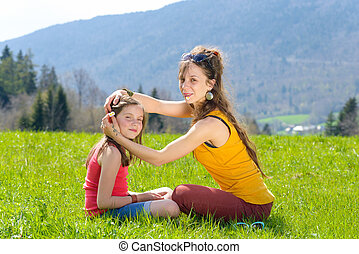 Mom and daughter play with flowers