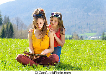 Mom and daughter reading a book