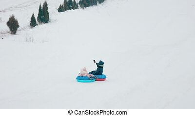 mom and daughter sledding