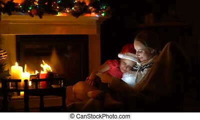 Mom and daughter spend the evening before Christmas together