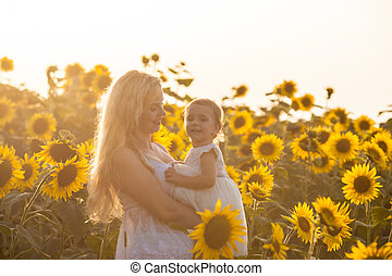 Mom and daughter - Mother and daughter in a sunflower field...