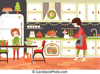 Mom and dauhter cooking together in the kitchen Christmas treat.