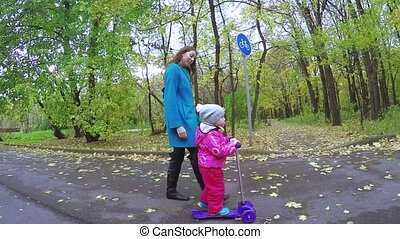 Mom and girl on scooter