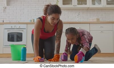 Mom and girl wiping floor with cleaning supplies - Pretty ...
