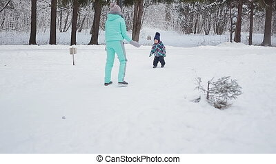 Mom and her pretty daughter in the winter