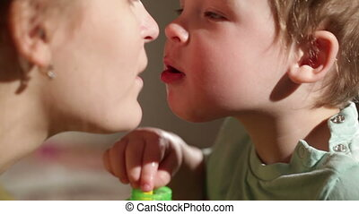 Mom and her son kissing. Lovely close ups.