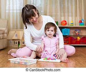 mom and kid play together