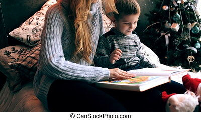 mom and little boy reading a book