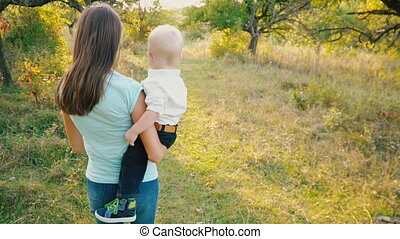Mom and son are walking in nature