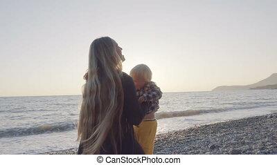 Mom and son having fun on the beach