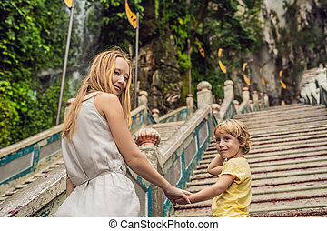 Mom and son in the background of Batu Caves, near Kuala Lumpur, Malaysia. Traveling with children concept