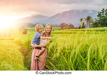 Mom and son travelers on Beautiful Jatiluwih Rice Terraces ...