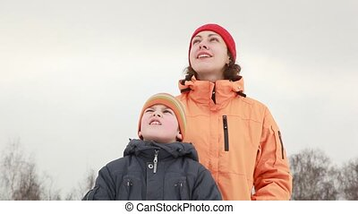 Mom and son watching sky