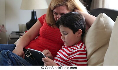 mom and son with digital tablet