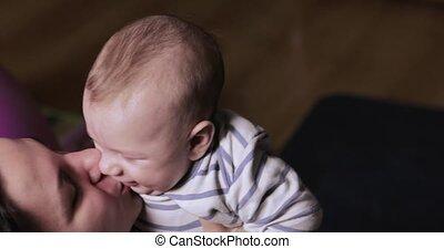 Mom blows a baby at home