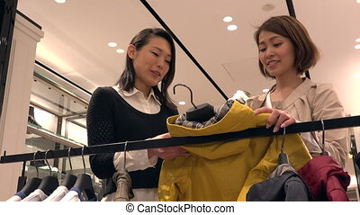 Mom Buying Clothes For Kid Woman Shopping For Children Jacket