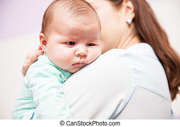 Mom comforting her newborn baby